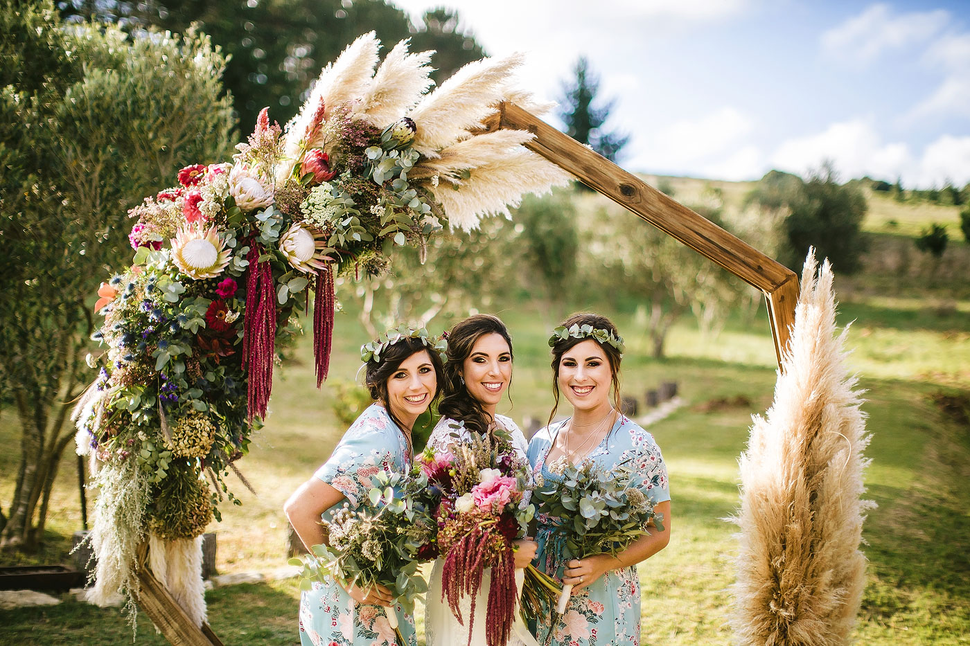 Bridesmaids with Floral Arch