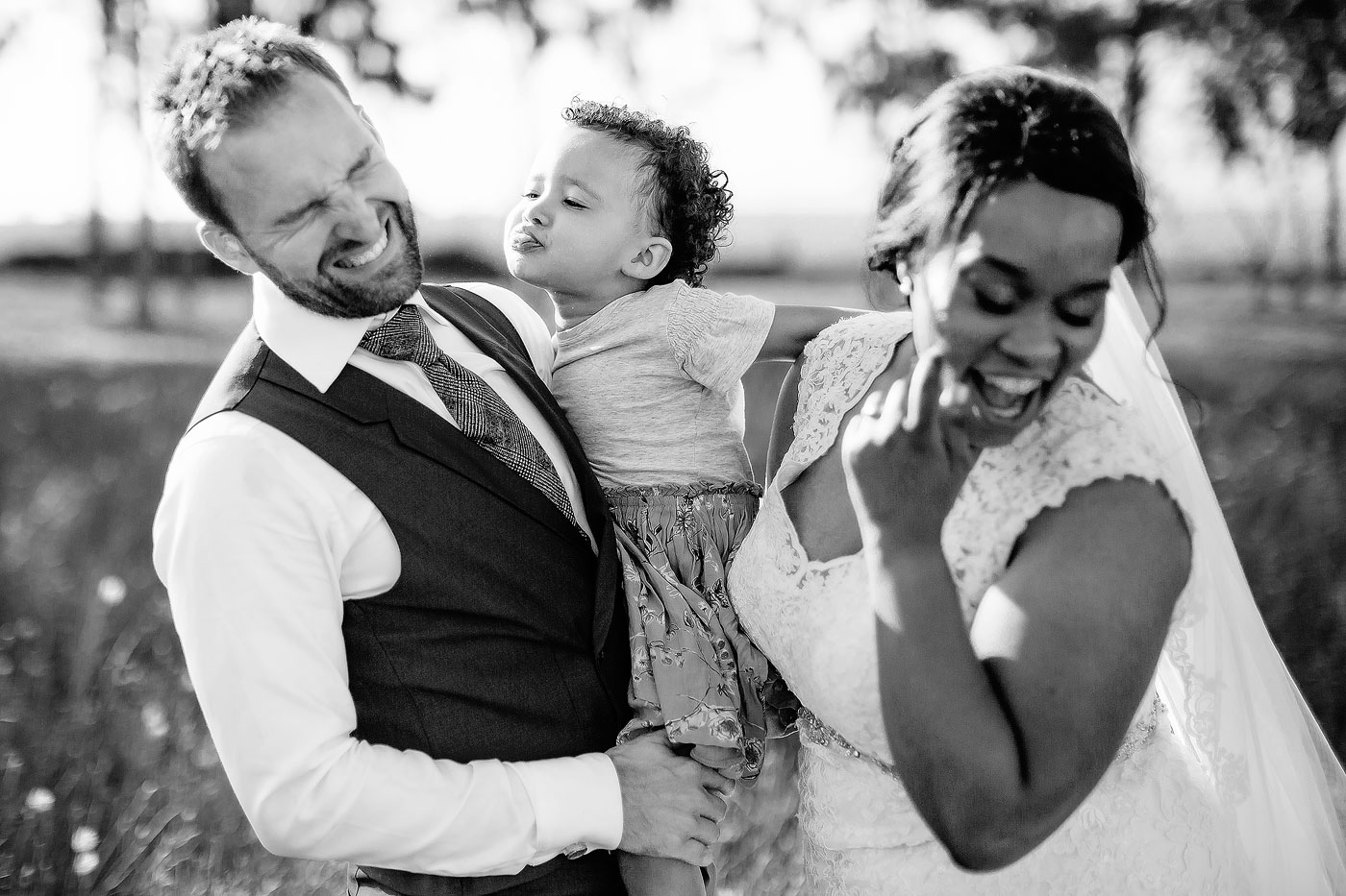 Wedding Family Moment between Bride Groom and Daughter
