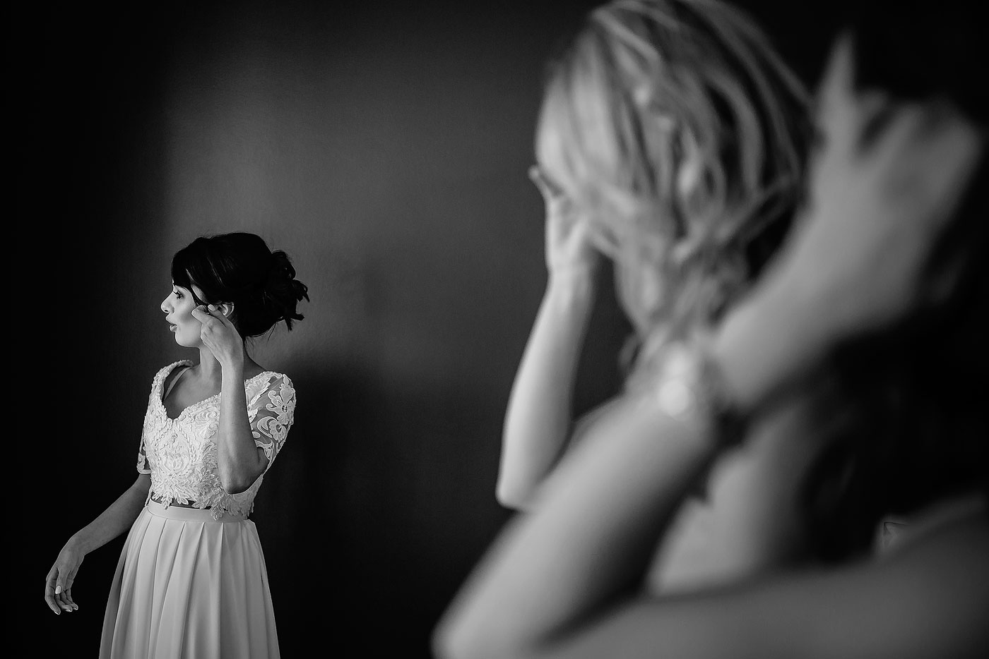 Bride putting on her Earrings in the Bridal Room