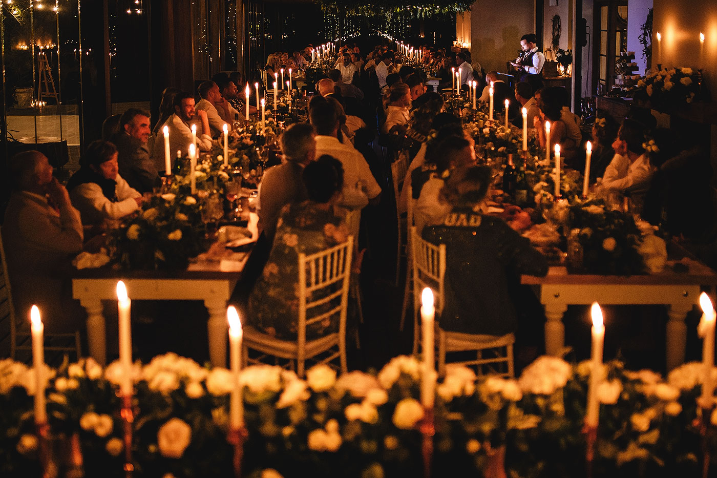 Groom speech with candles and guests listening