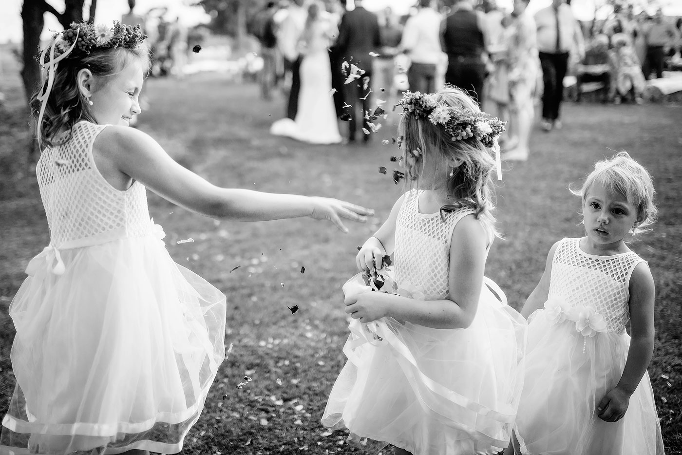 Wedding funny moment with flower girls and confetti.