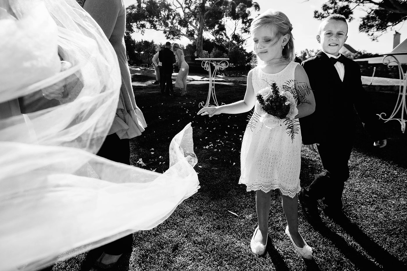 Kids at wedding playing with a veil