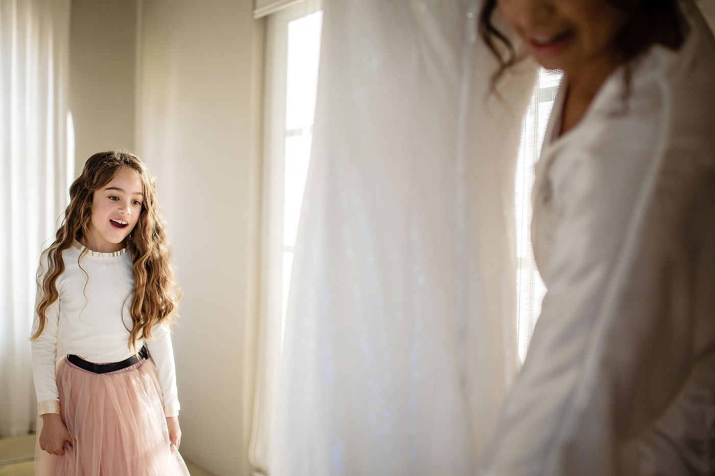 Flowergirl reacts to the wedding dress with Bride