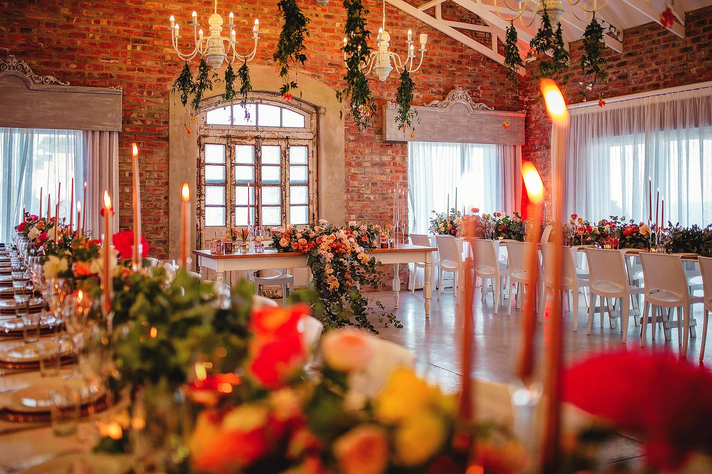 Warm inviting colour palette with extravagant wedding decor flowers.