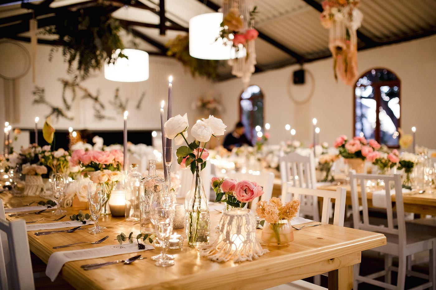 Elegant wedding flowers and reception decor with beautiful lighting.