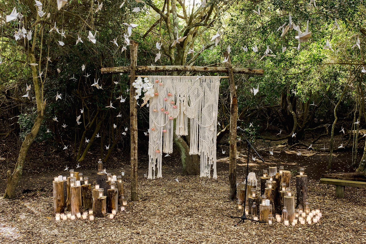 Forest Wedding Decor and Altar with decorations and paper origami cranes.