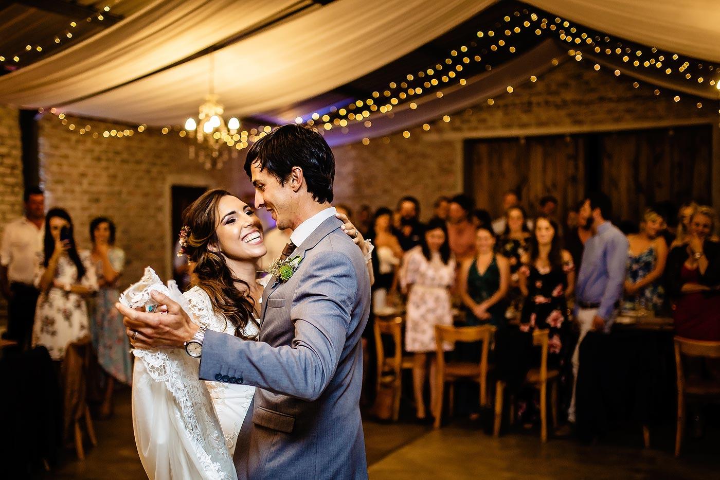 Fun moment between wedding couple on the dancefloor