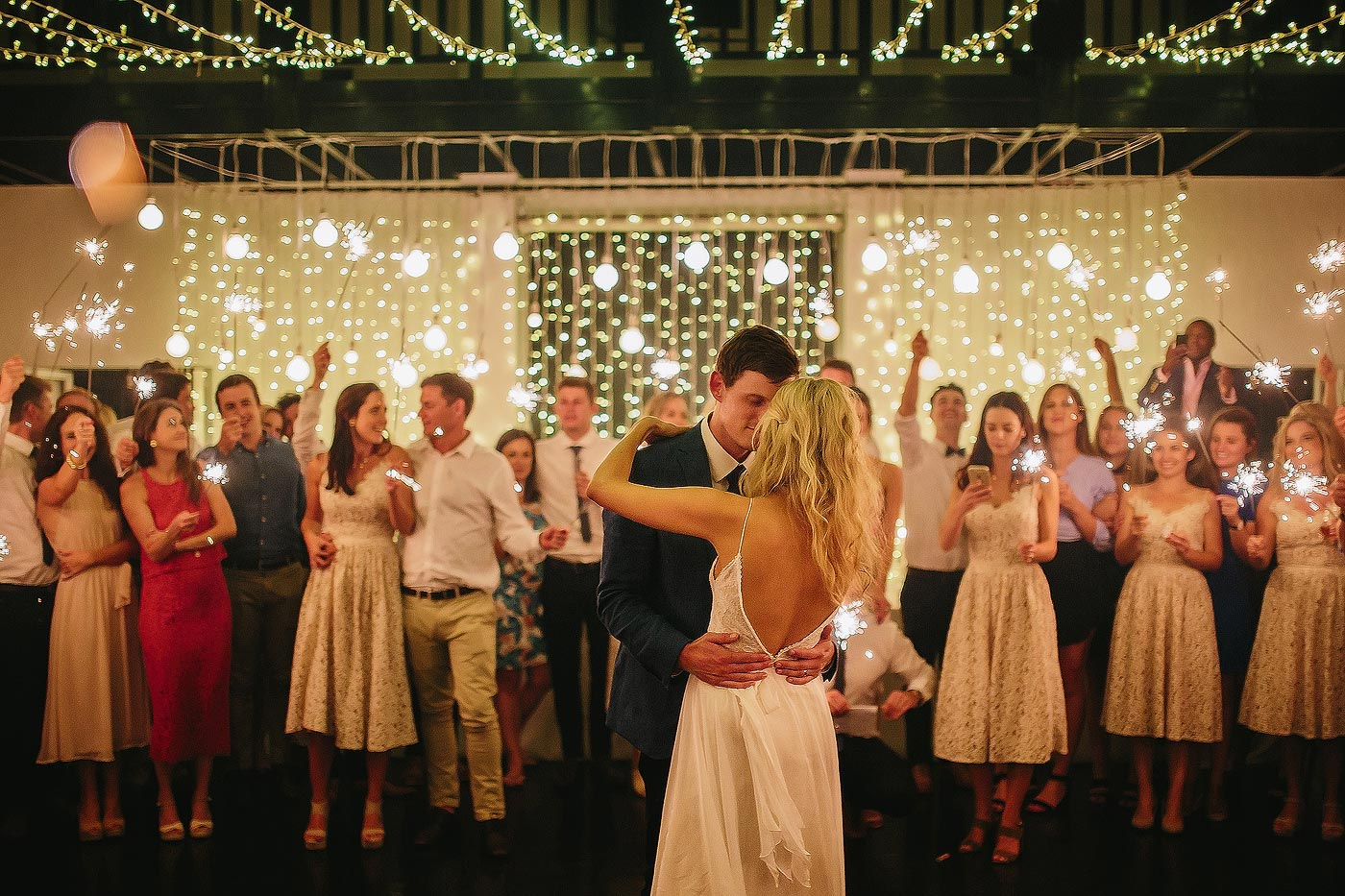 Elegant wedding first dance with fairy lights in Plettenberg Bay South Africa.