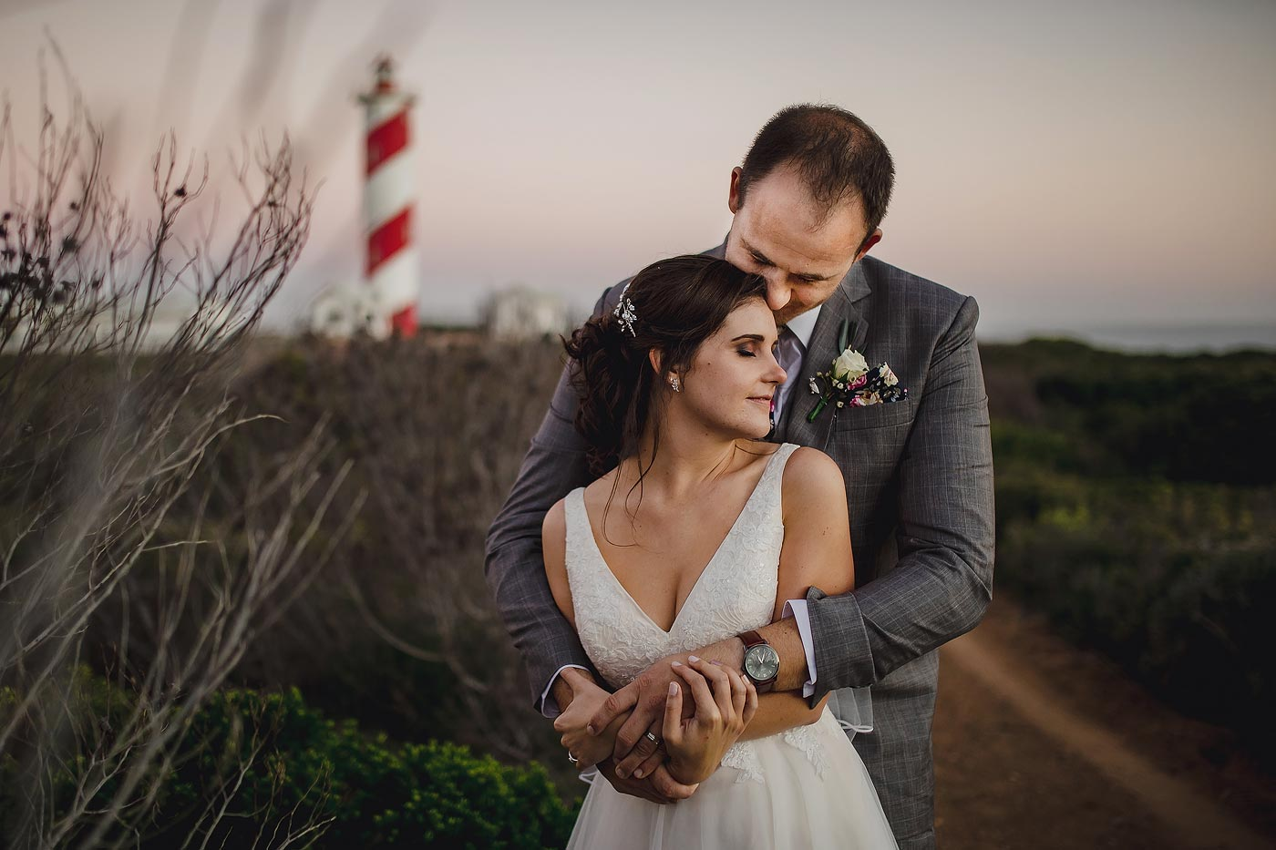 Copy of Classic Wedding Couple Pose with lighthouse on the coast of South Africa