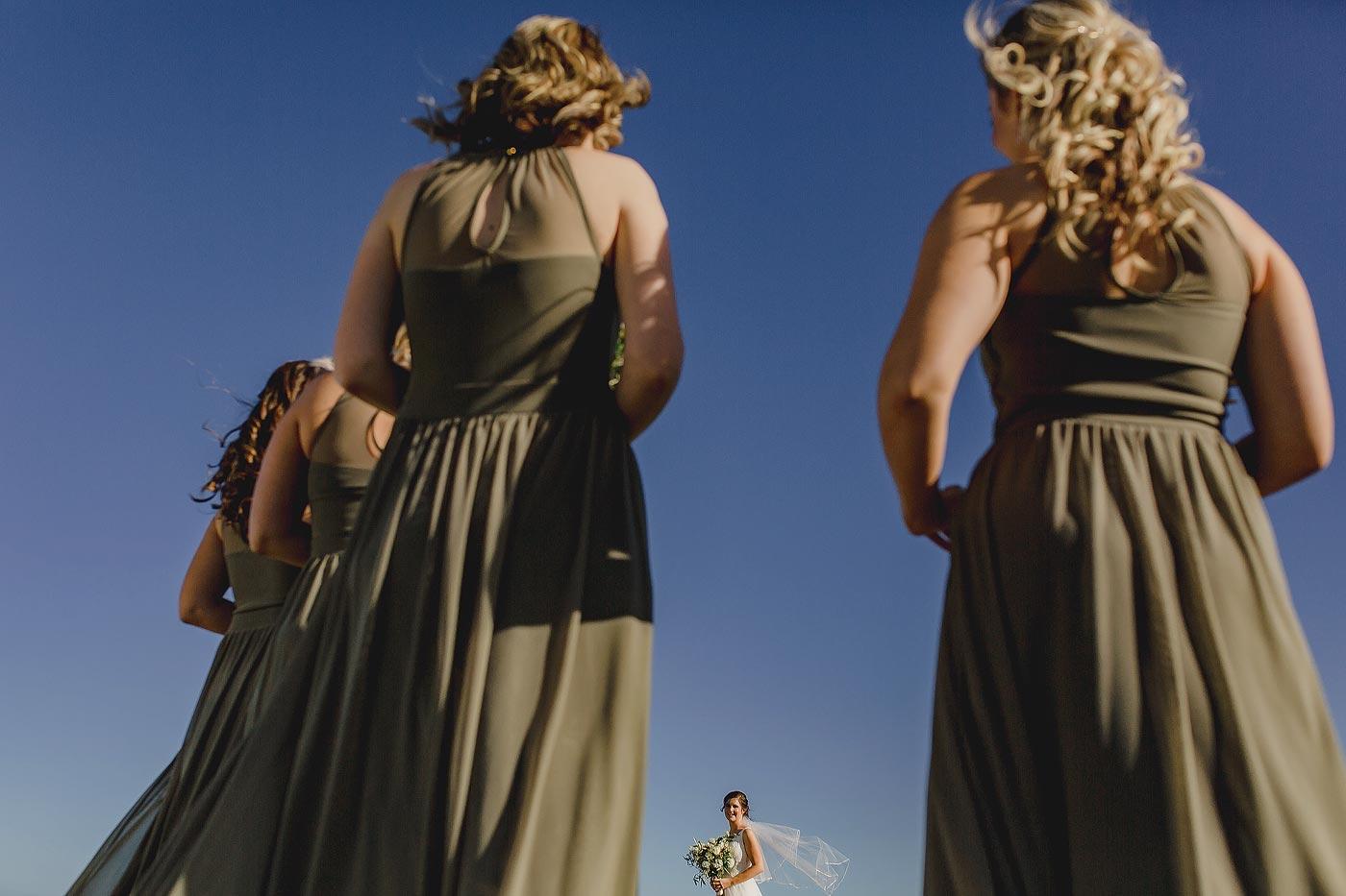 Copy of Creative Bride and Bridesmaids Portrait during a winter wedding.