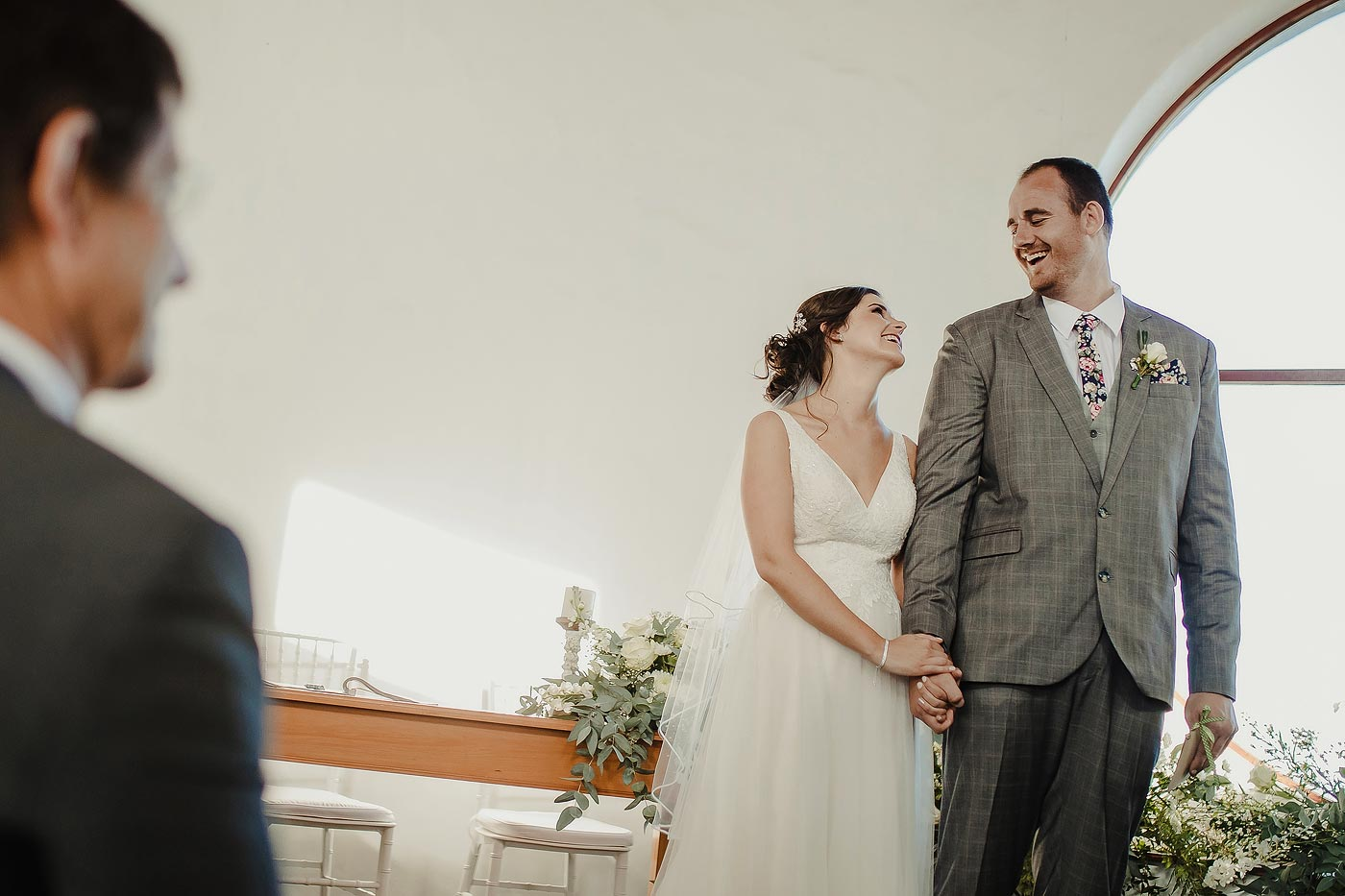 Copy of Bride and groom laughing at wedding ceremony.