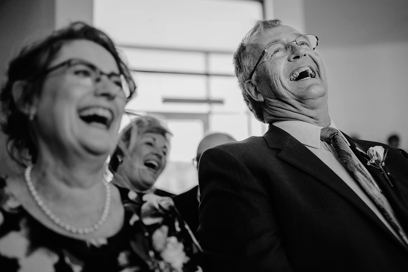 Copy of Parents of the Groom laughing at wedding ceremony in South Africa.