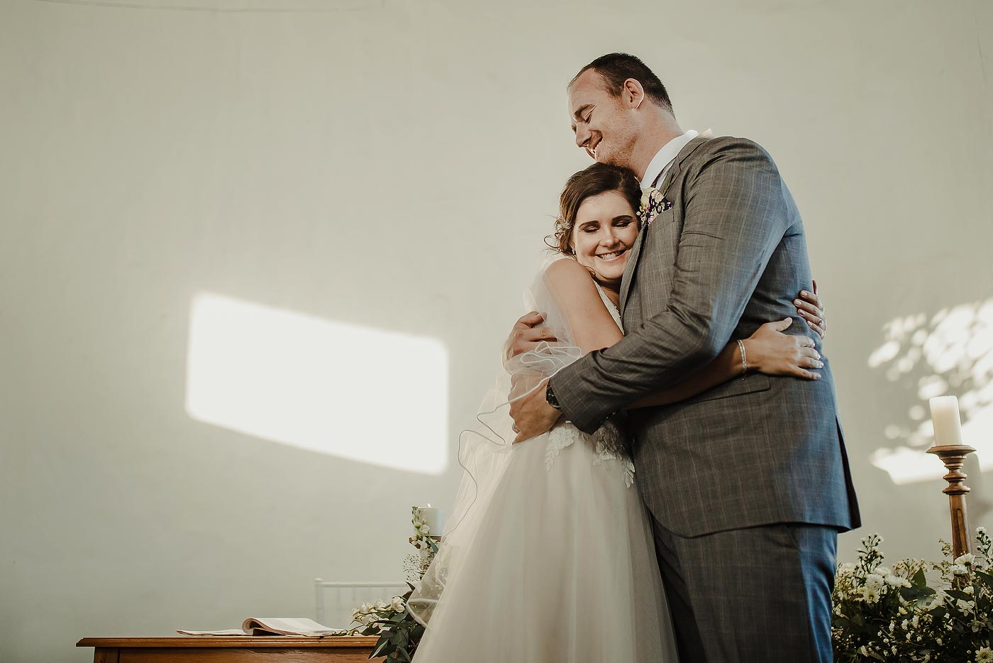 Copy of Wedding Couple Embrace before wedding ceremony in the Garden Route South Africa.