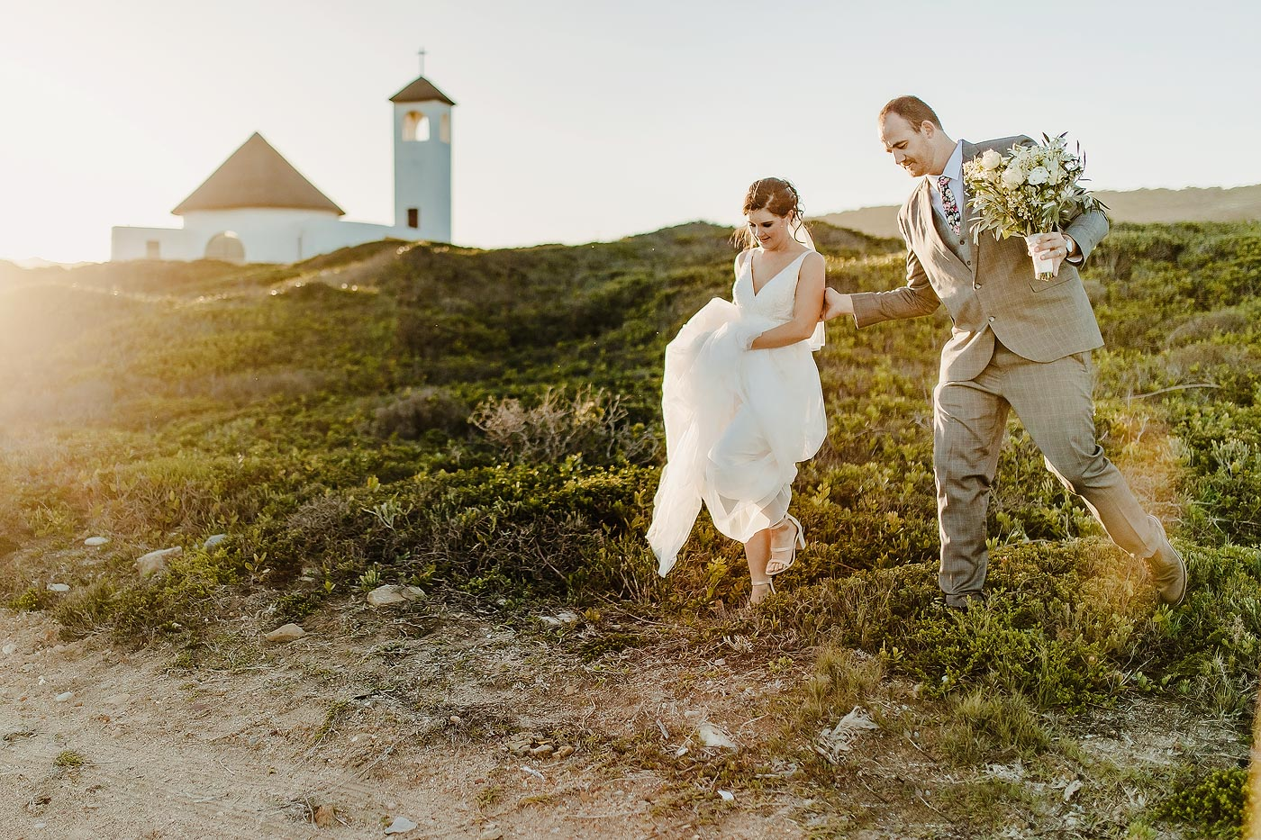 Copy of Bride and groom natural Photo between fynbos at the Ocean.
