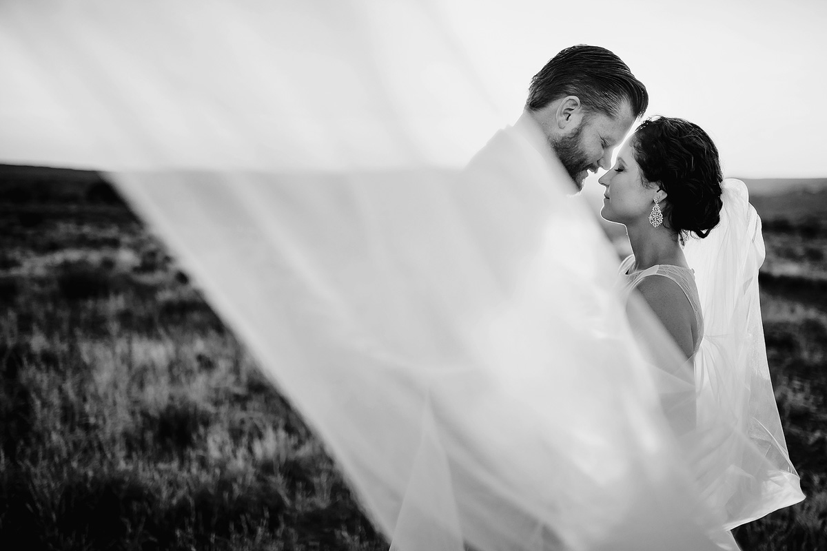 Intimate moment with veil between bride and groom at wedding in Eastern Cape
