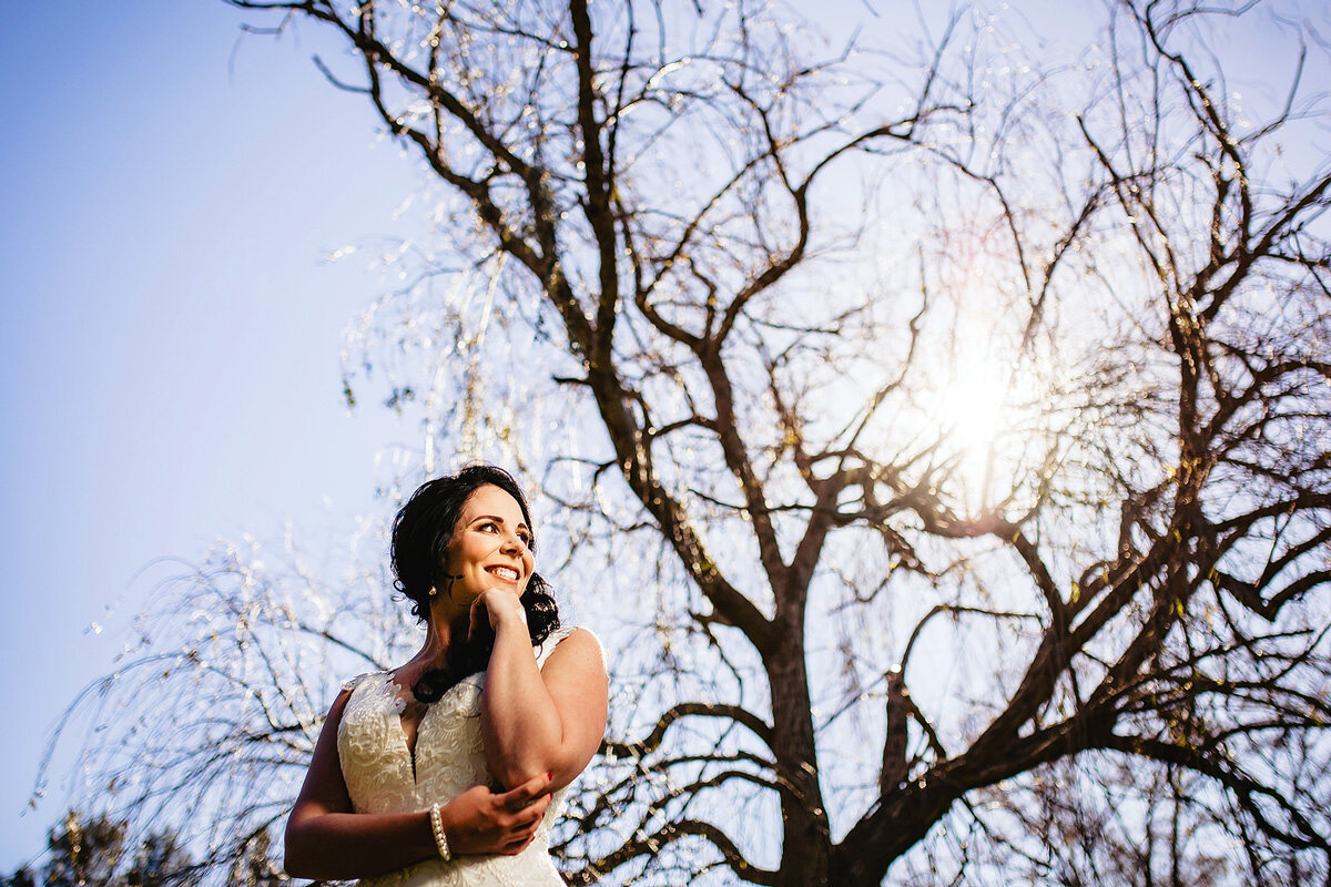 A creative portrait of an elegant bride in bright sunlight in South Africa.