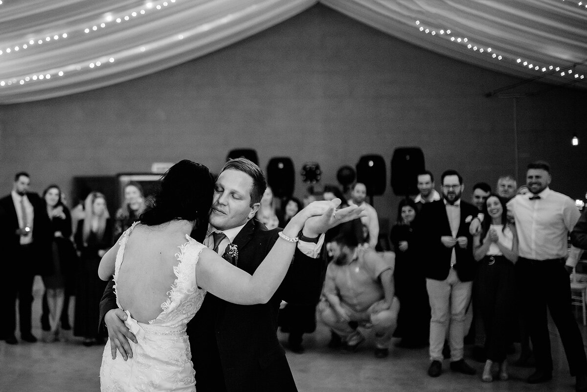A first dance moment under fairy lights at a South AFrican Wedding in Waboomskraal.
