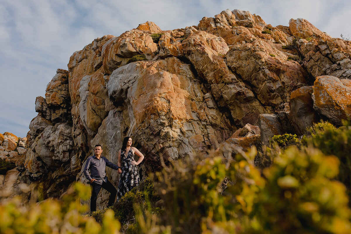 Creative couple engagement shoot with big boulders