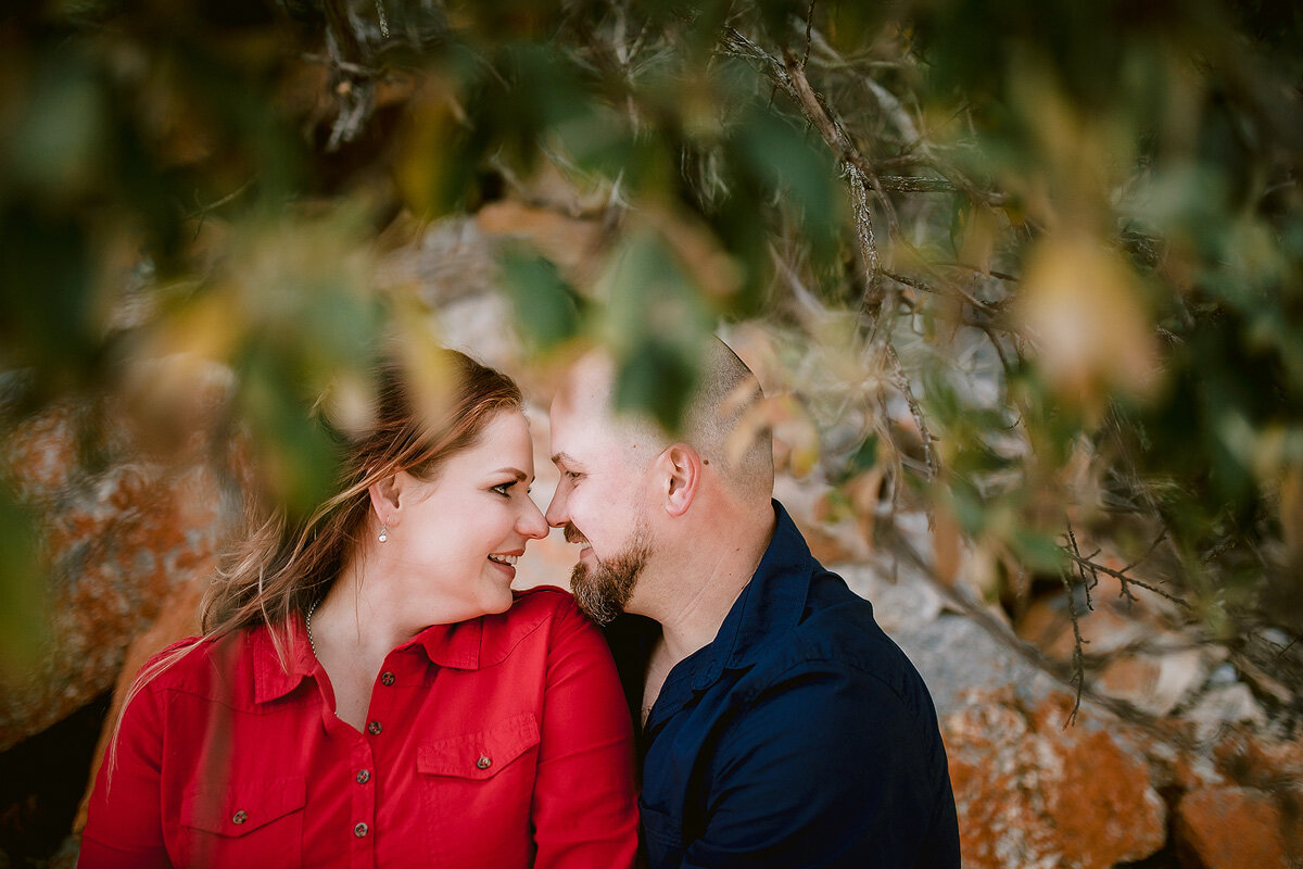 Intimate loving couple portraits in between trees