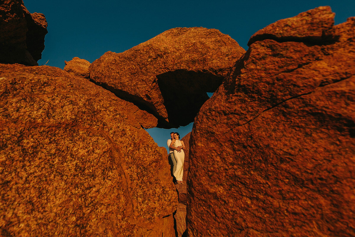 Creative sunset couple portraits with boulders in Namibia