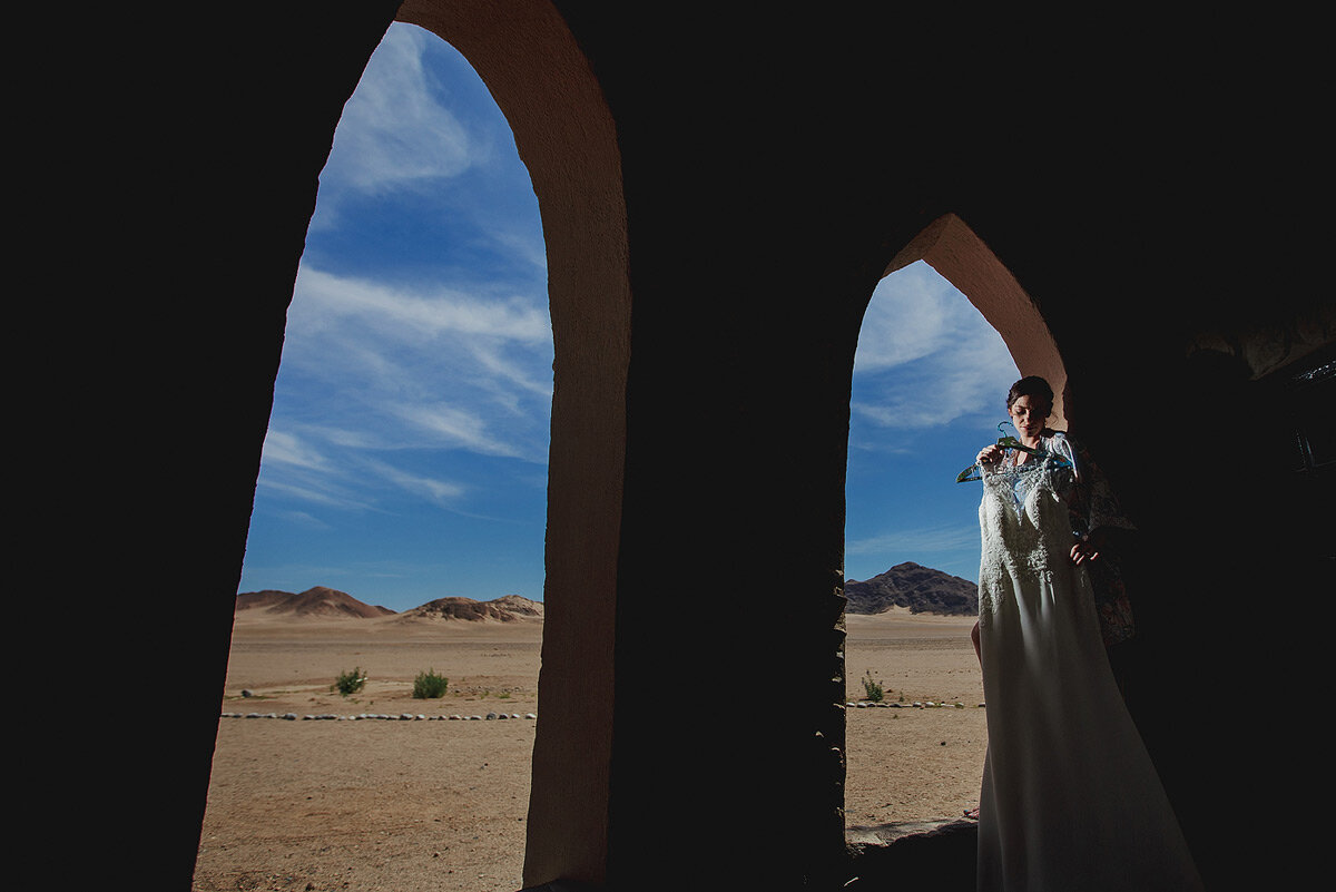 Bride and wedding dress with Namibia Desert in the backround