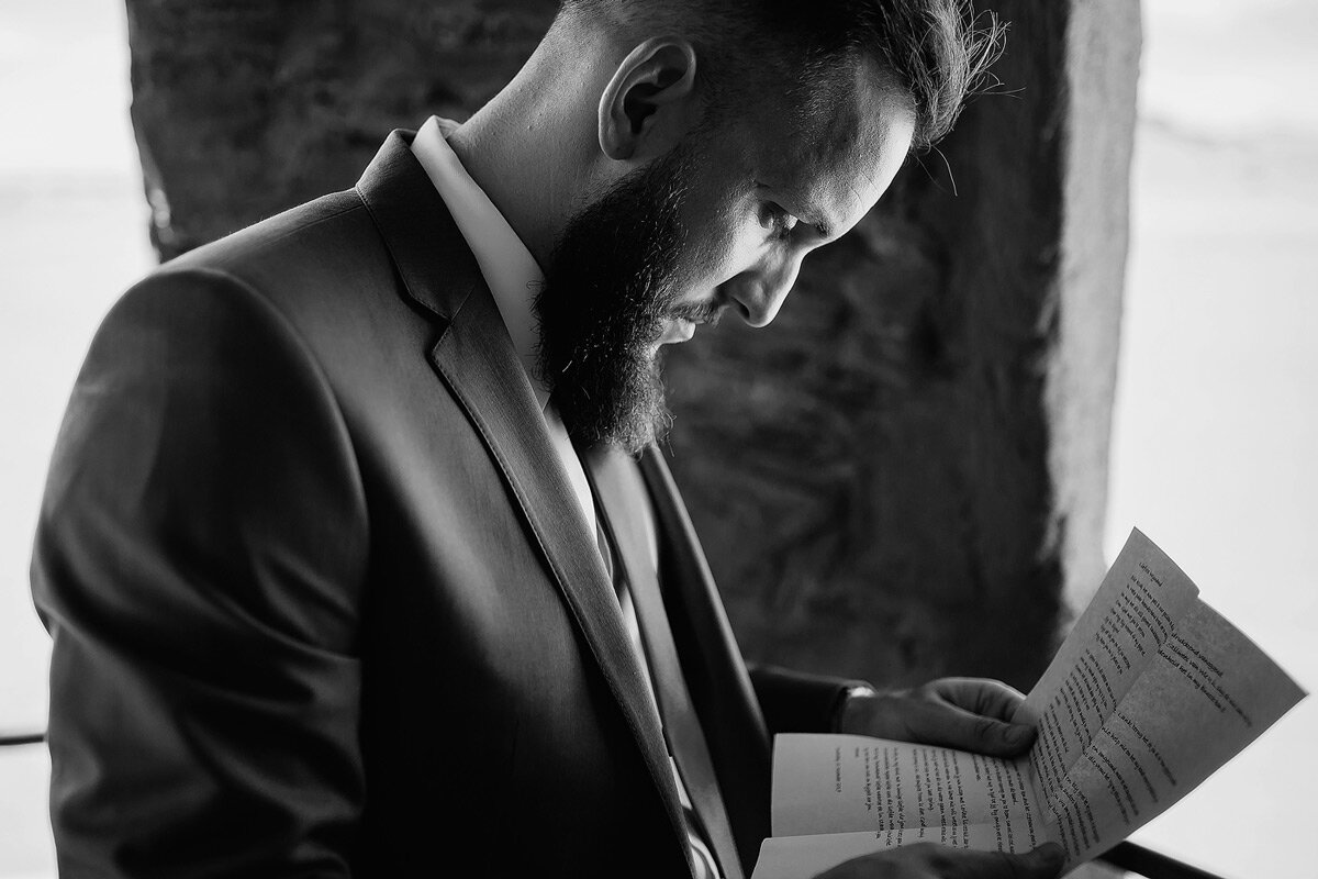Groom reads emotional letter from bride on his wedding day.
