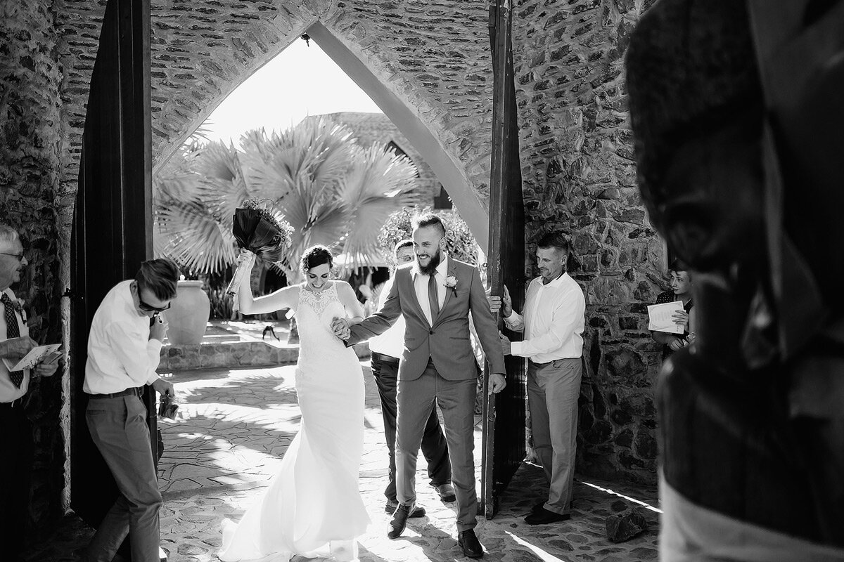Wedding exit with confetti after ceremony at Le Mirage Resort in Namibia.