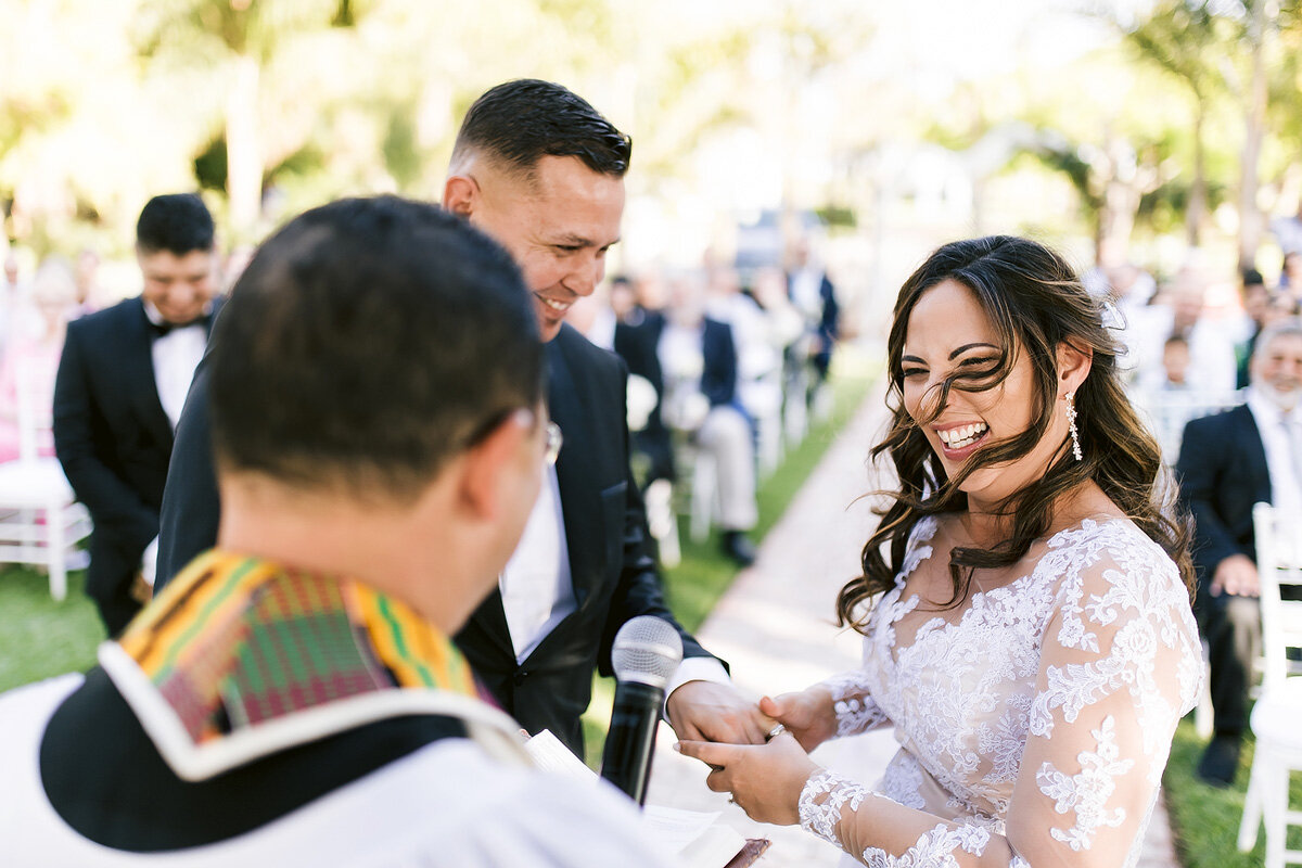 Laughing Bride moment during wedding ring exchange in Upington.