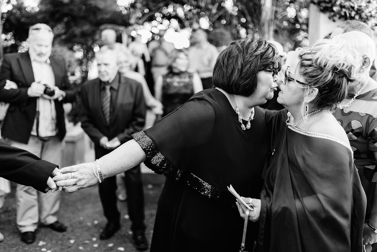 Wedding Moment Kiss between guests at wedding in South AFrica.