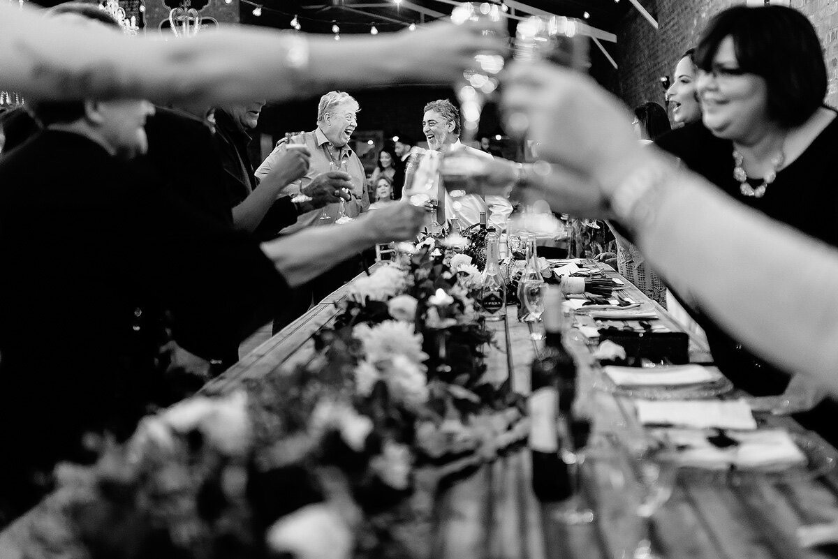 Guest toast with champagne after the wedding speeches in Upington South Africa.