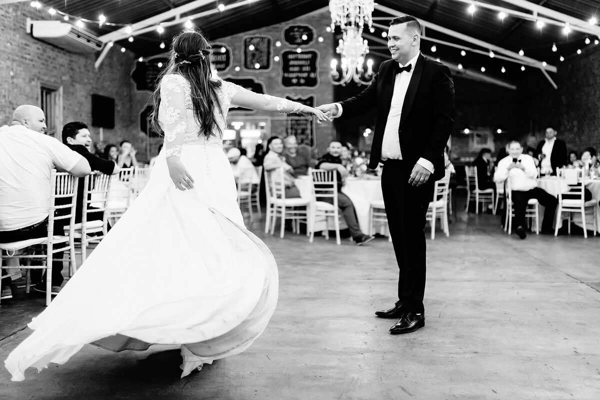 Bride and Groom wedding First dance moves with fairy lights in the reception venue