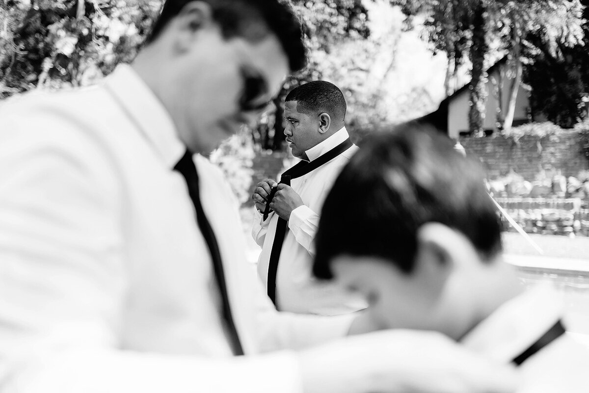 Groomsmen getting dressed before the wedding in the Northern Cape.