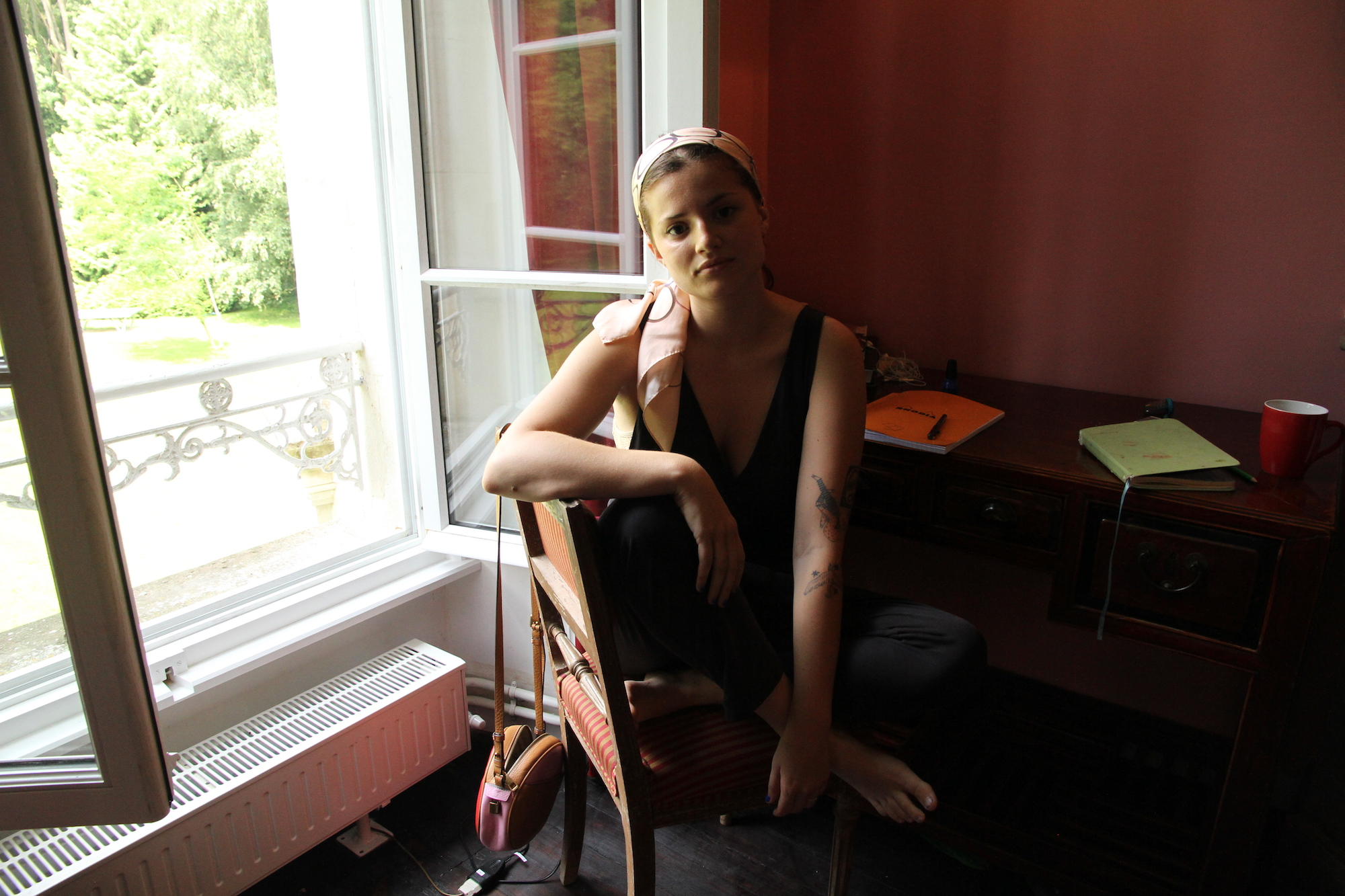 Kenly at her writing desk during the residency @ Centre Pompadour, June, 2018