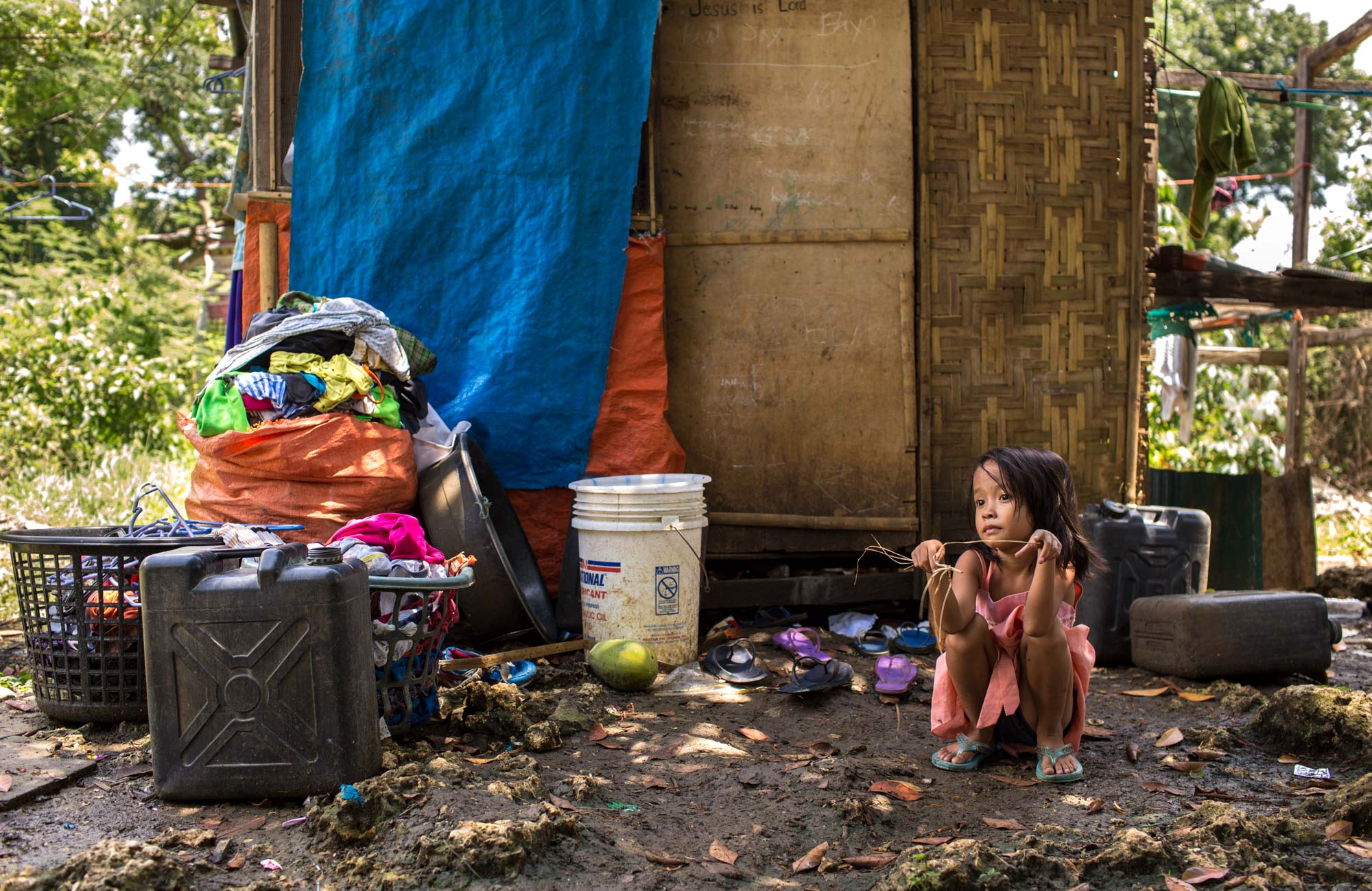 Poverty and inequality in the Philippines remain a complex challenge. The country has lost its once great wealth due to unemployment issues and unchecked population growth and is now considered a third world country.  Approximately 21% of Filipinos live below the national poverty line, earning less than $1,982 per year. This equates to 26 million Filipinos who are poor, with 12 million lacking the means to feed themselves. Over four million families are living in unsafe, unsanitary and unsustainable conditions. 7.6% are living in extreme poverty and 10.5% are considered food poor. For every 1,000 babies born in the Philippines, 22 die before their first birthday. In comparison, the rate for Australia is 3 per 1000 babies born.  The rich get richer and the poor get poorer due to the inequality in income distribution and a high rate of corruption amongst people in power. A lack of quality education and lack of jobs are also a large factor in poverty. Overpopulation also contributes hugely, with the majority Catholic country doing little family planning, meaning more mouths to feed on low incomes and less jobs. Child labour instead of attending school being another one of the effects. Another flow on effect is poor health due to sub standard living conditions and not being able to fulfil dietary requirements.  This series is a documentation of some of the residents of the Philippines. I spent time with the  Energia Kids Project ; a great group of friends with no funding that are based in Australia and travel regularly to the Philippines and have been feeding and helping Filipinos for the past 3 years. I made these photographs at a local school, a squatters community and an orphanage, to help tell the story of the people that they help.  The scary part is that the people involved in this project were randomly selected. I didn't chose people based on prior knowledge of their situation. Which leaves you to think what other stories are untold if these are just 16 out of th