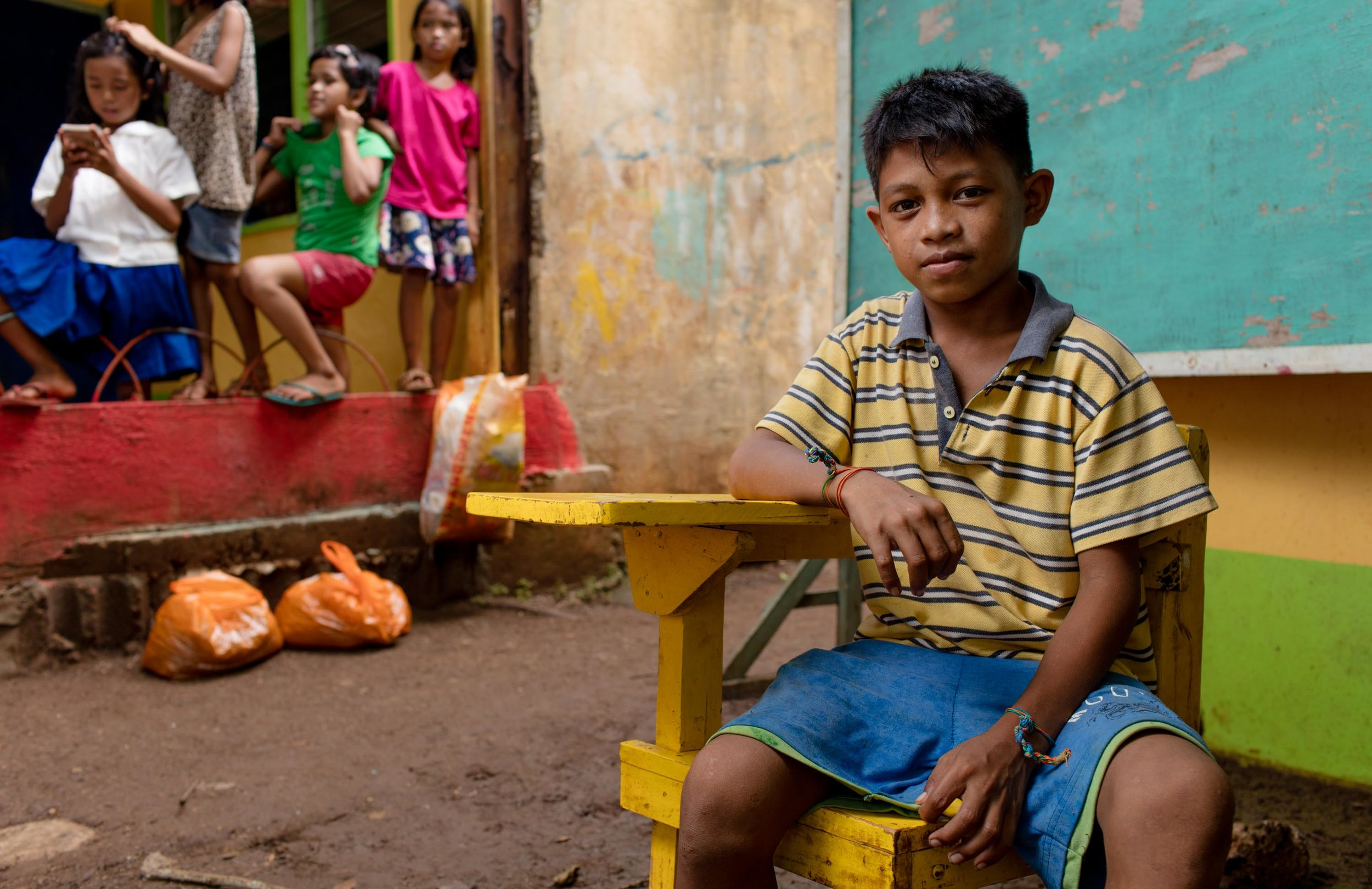 My name is Gabriel and I'm 12 years old. My Mother is a laundry woman and my father doesn't have any work. He makes money for food by gathering fire wood and selling it. It's a very long walk for me to get to school from my house. We don't have enough money for food at school so I don't eat when I'm there. If I have time away from studying, I go to the beach and beg for money so I can buy food for me and my brothers and sisters. There are 13 children in the family and two of my brothers have died from diseases already. Some of my brothers don't go to school because of bullying and they are always repeating their grades. My dream in life is to get a job so I can help my family.
