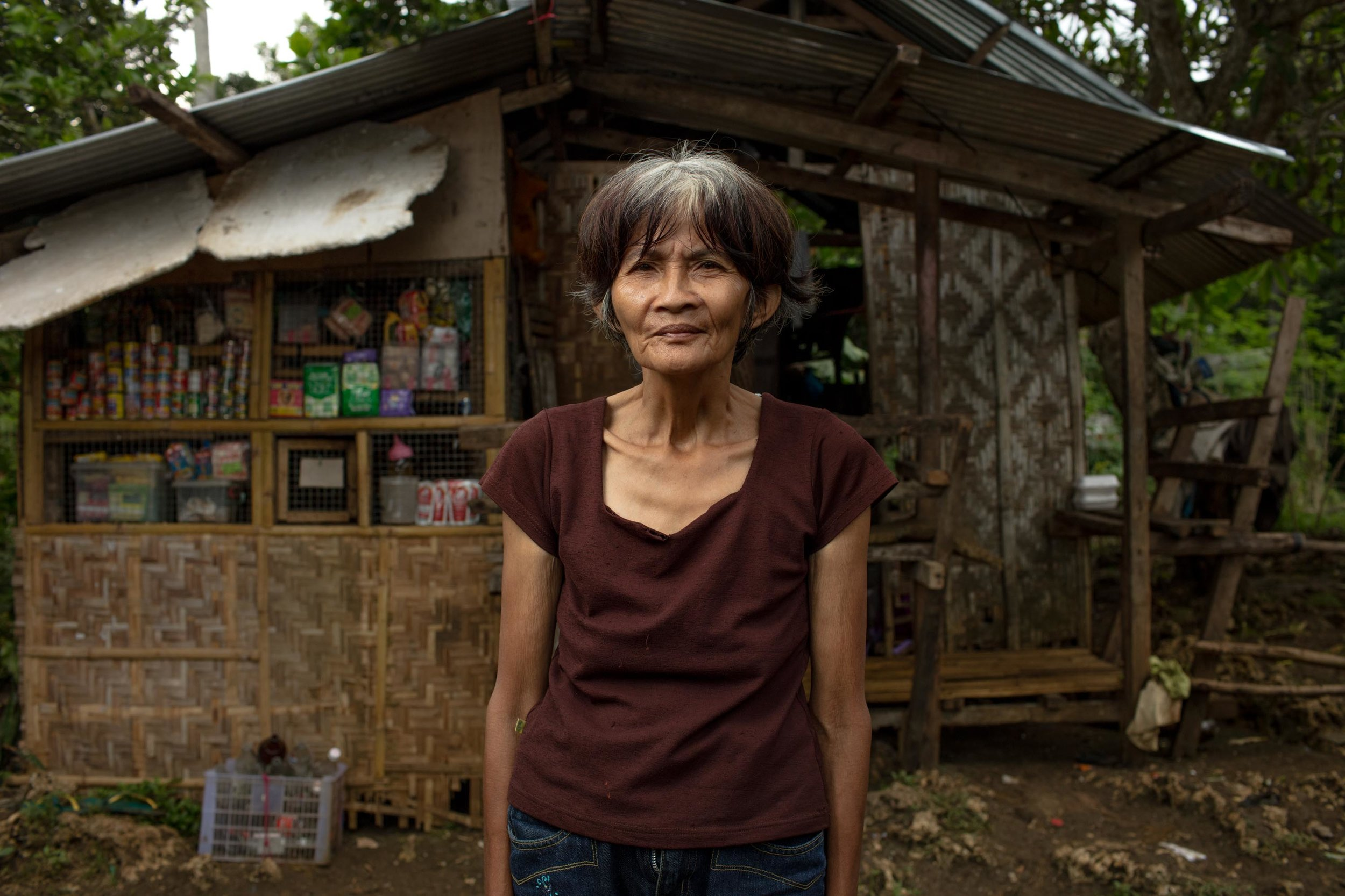 My name is Nieves and I am 62 years old. I collect Kangkong (leafy vegetables) and sell them on the sidewalk, so that I can buy rice to eat. Before that I sold pineapples. Due to poverty, I wasn't able to send my children to school. One of my married Daughters is staying with us at the moment so there are 6 of us living in my small bamboo hut. My Daughters Husband drives a motor cab but usually only makes 100-200 pesos a day ($3-$5). I have lived in this squatter's community for over 12 years, ever since we noticed the owner of the land never visiting. We are really struggling with poverty and don't even have lights or running water. We can't connect water or power because the land isn't ours and we cannot afford to rent a house somewhere. We just wait and hope that one day someone can solve our problem. I've had a cough for one month straight and I hope its not Tuberculosis. I wish that God gives me a long life because I want to see my children and my grand children improve their situation and be happy. I would love for us to be able to eat three times a day.