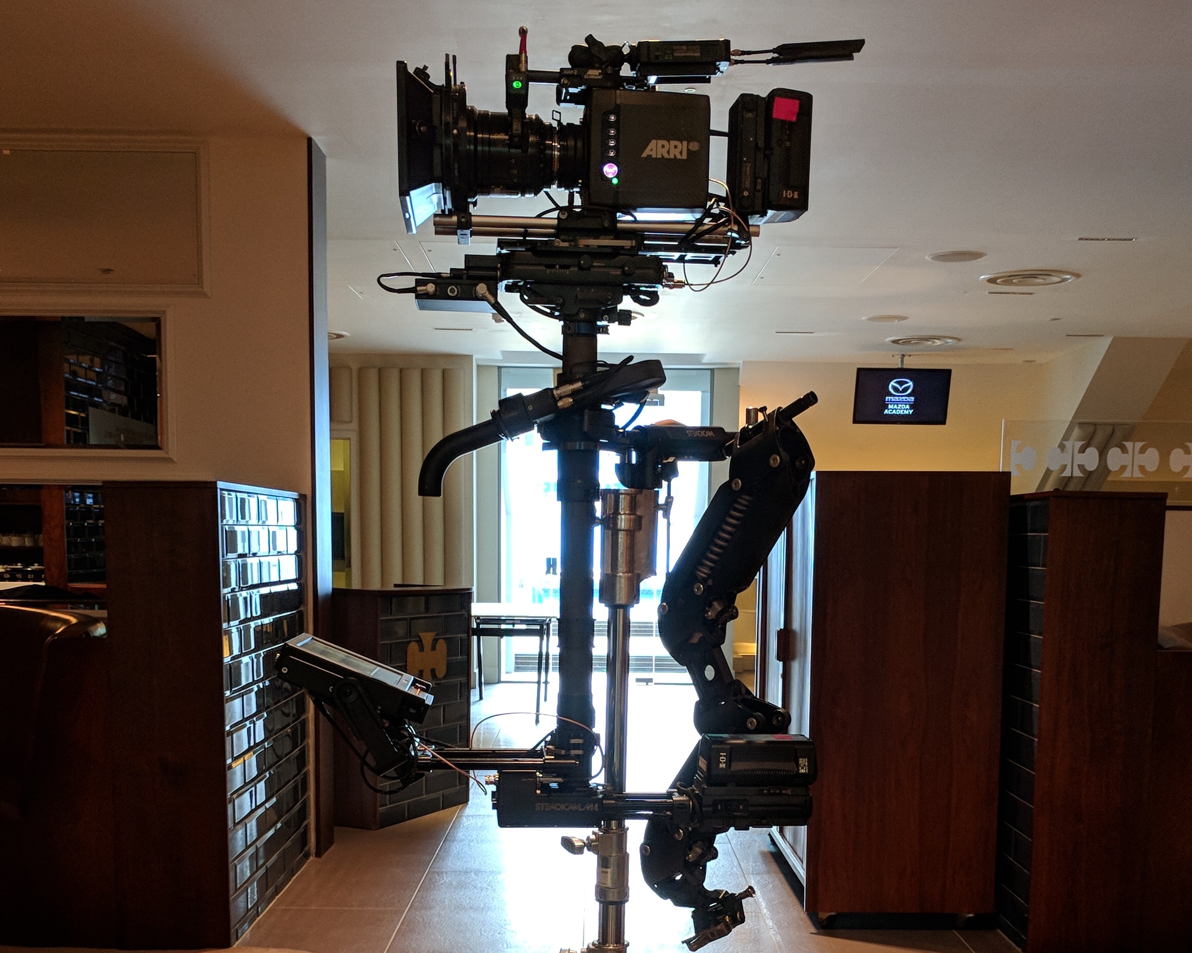 STEADICAM SEUP - Steadicam M-1A small fraction of the many features that come standard on the new Steadicam M-1 are three true HD lines, multiple high-amperage power ports top and bottom, and a vernier adjustable tilthead.G70x ArmSmooth, innovative, and durable, the G-70x Elastic Arm is performance adjustable and smooth operating with a 70lb. lifting capacity, and a 29″ boom range.Ultra VestUltra vest, complete with socket block, cross back straps, emergency quick release.Note* never pull the blue strap!