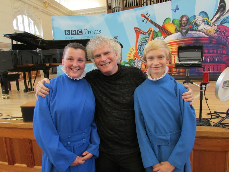 The Head Girl and Boy Choristers with Sir Simon Rattle OM at the BBC Proms.