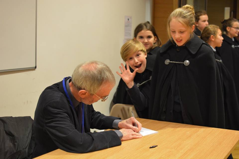 The choristers line up for Howard Skempton's autograph following their premiere of his Preces and Responses