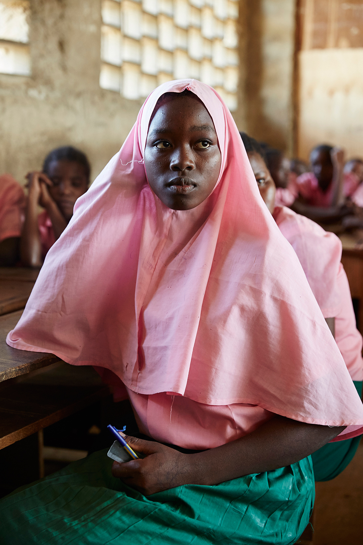 Pupil listens to her peers speak in a girls forum meeting. Marimani Pre-School. Mwakirunge, Mombasa. June 2016