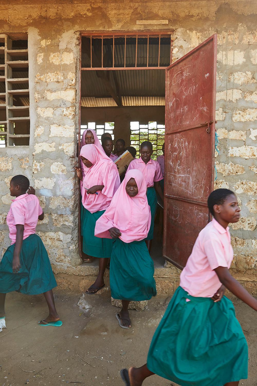 Girls spill out of a girls forum meeting at Marimani Pre-School. Mwakirunge, Mombasa. June 2016