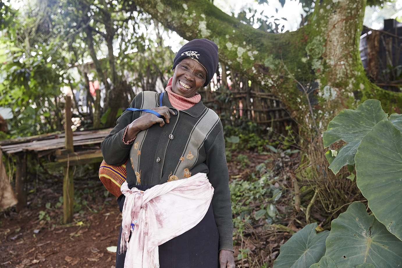 Jane is a farmer from Makomboki, Kenya. She has 3 acres of land that she uses to grow tea or income generation along with vegetables for her families consumption.