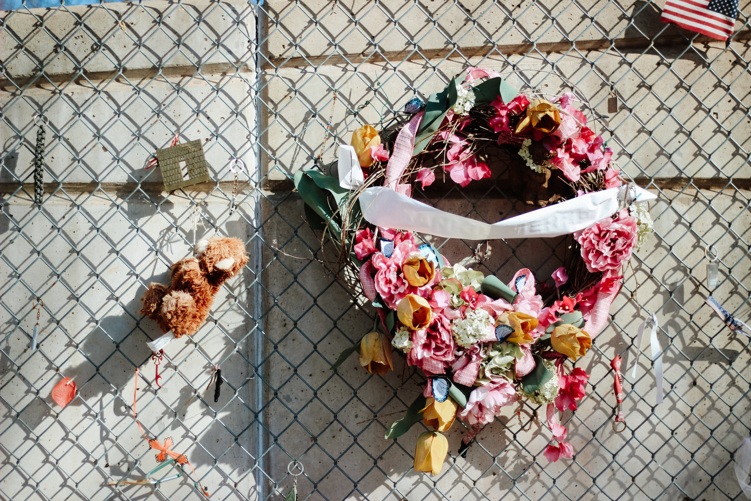 Items of personal significance are hung from the chainlink fence at the Oklahoma City National Memorial.