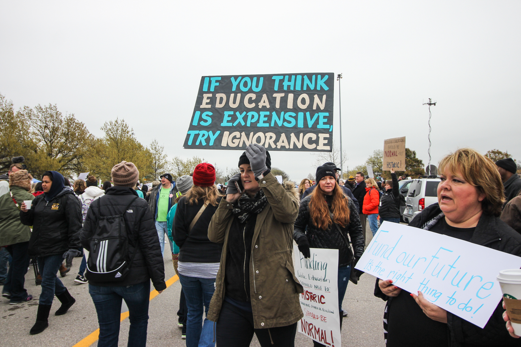 A protestor carries a sign in a picket line.