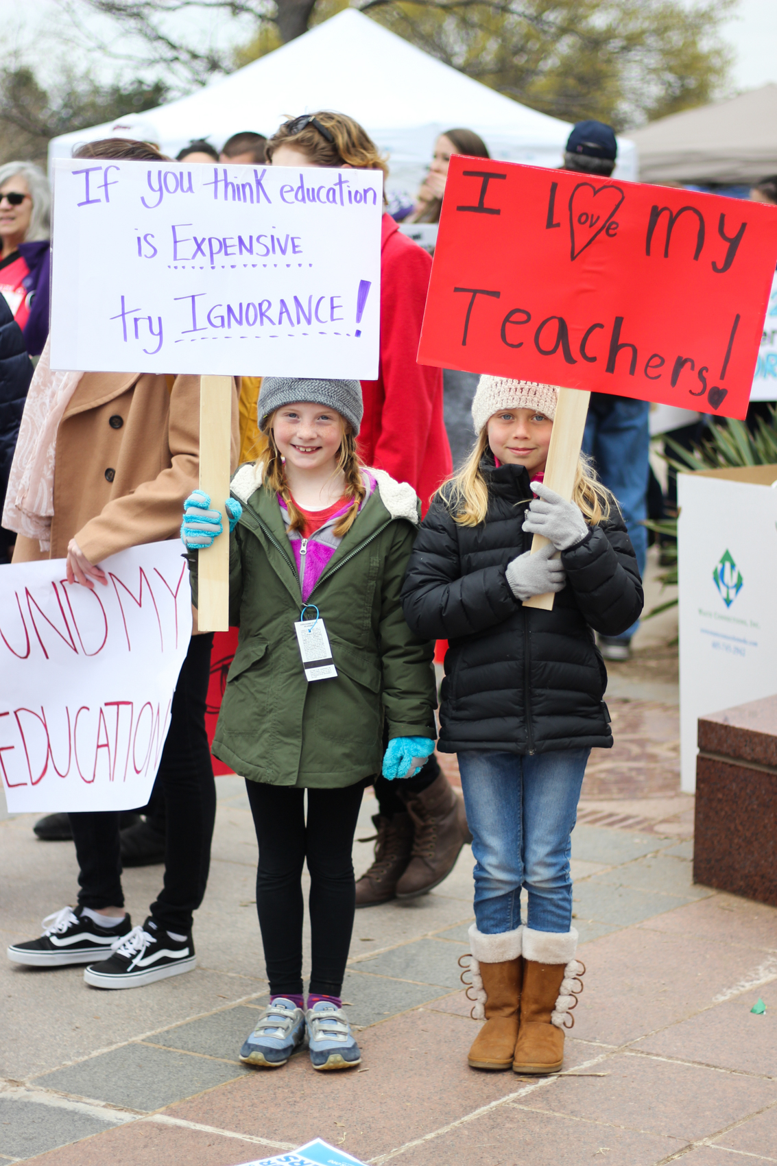 "Jennifer (right), Gatewood Elementary Student, 8 years old MR: ""Why are you here today?"" J: ""I'm here to support teachers."" MR: ""How do you feel about your own teachers?"" J: ""Good!"" MR: ""Who's your favorite teacher?"" J: ""Mrs. Platt."" MR: ""Why?"" J: ""Because she's nice.""   Lilly (left), Nichols Hills Elementary Student, 7 year old MR: ""Why are you here today?"" LS: ""To support my teachers."" MR: ""Why do you think it's important to support teachers?"" LS: ""'Cause they teach us and they support us in education!"""