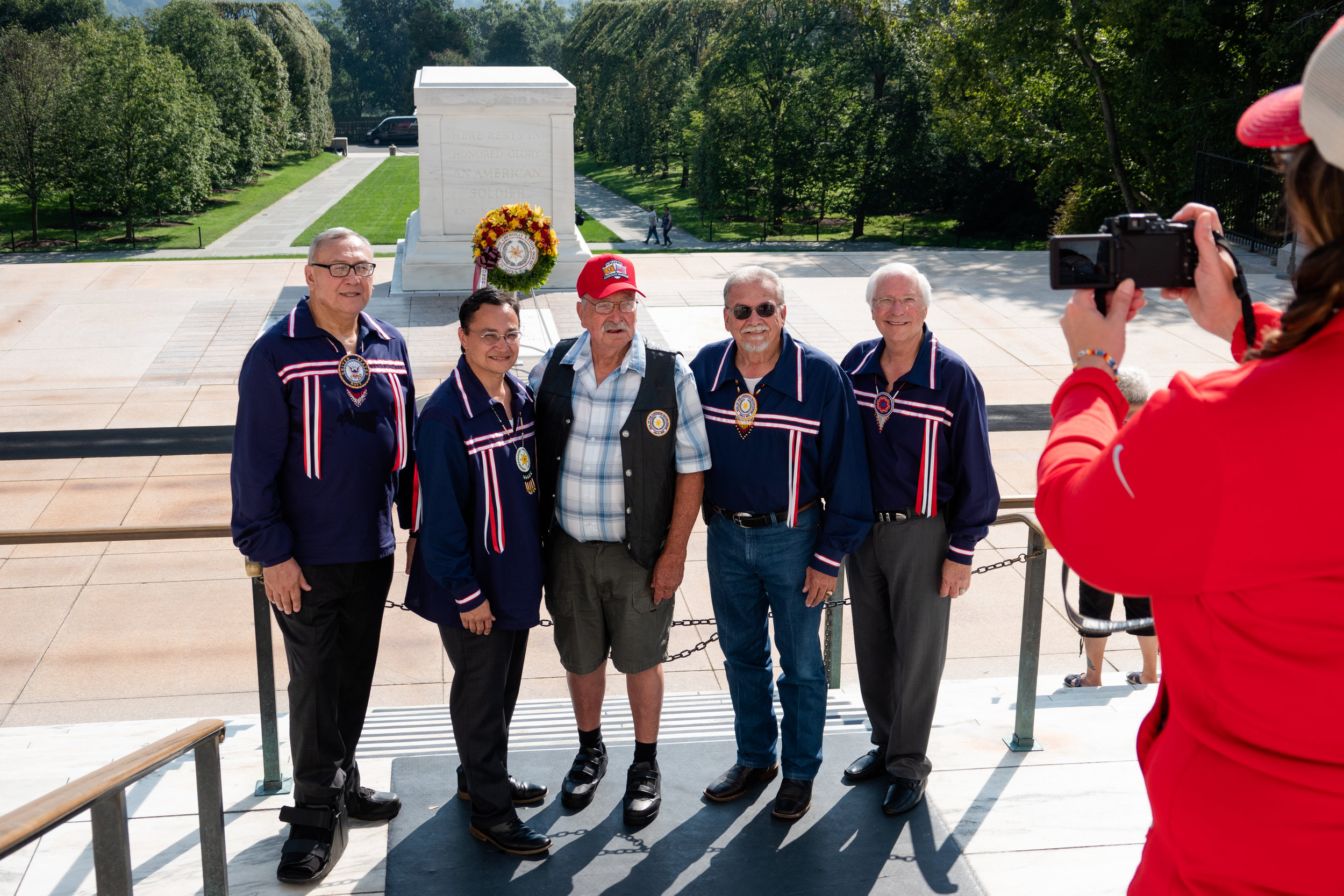 Members of Cherokee leadership pose for a photo with Korean War veteran Jimmie Routh in front of their wreath at the Tomb of the Unknown Soldier.