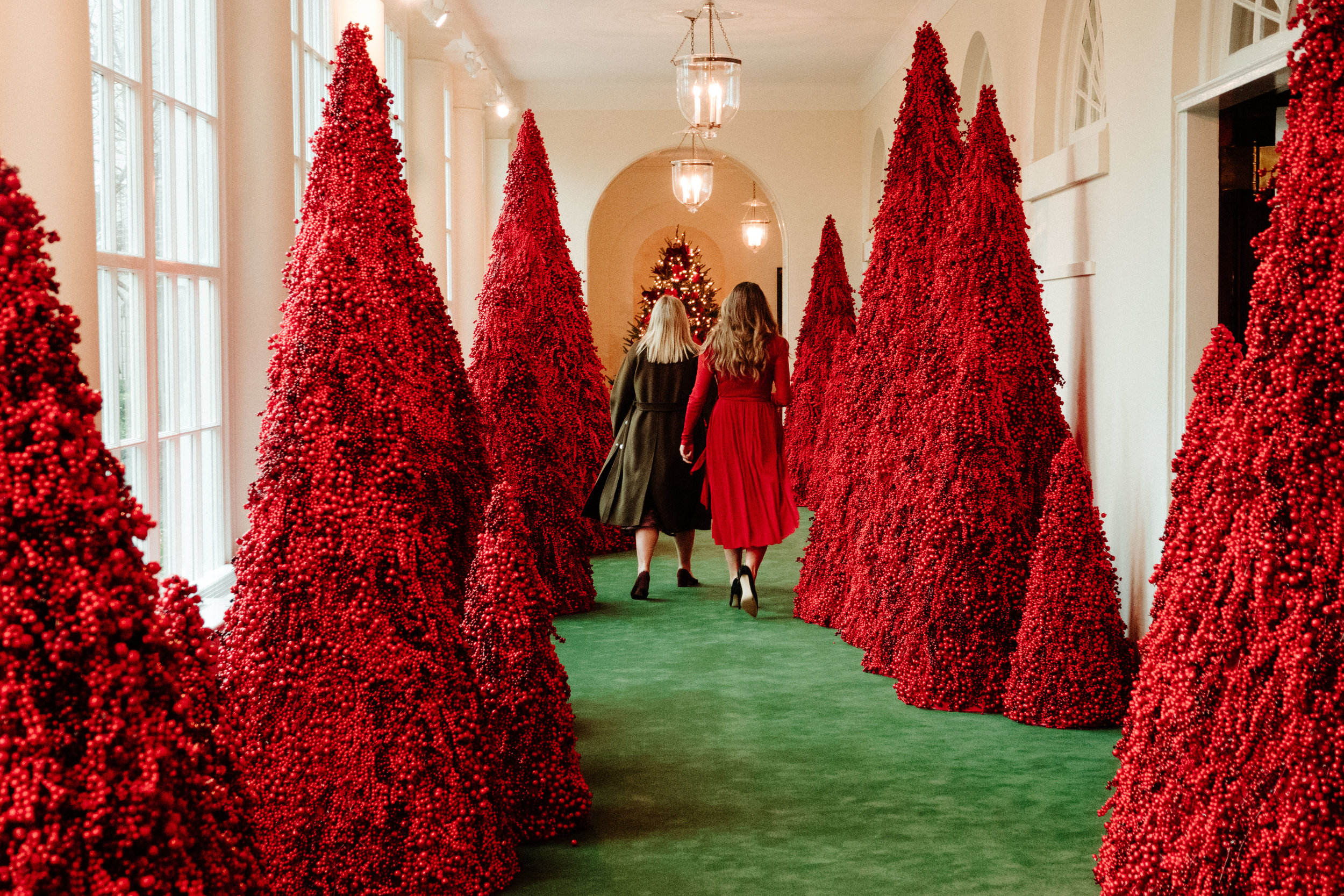 A pair of women walk down the freshly-decorated Ground Floor Corridor in the East Wing of the White House in Washington, D.C. on November 25, 2018.