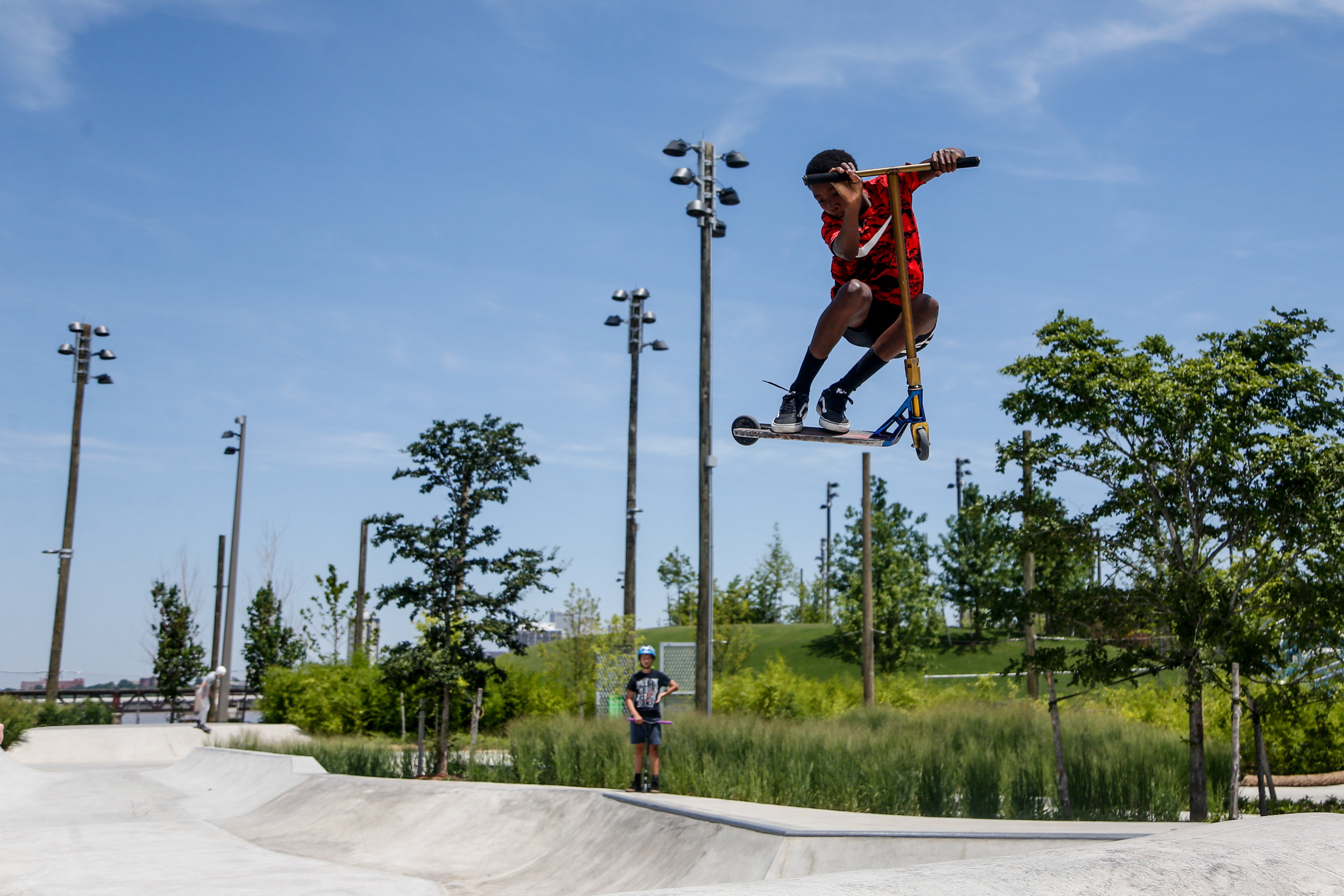 Isaiah Bridges, 13, soars on a scooter at the Skate Park in Tulsa's Gathering Place on June 10, 2019.