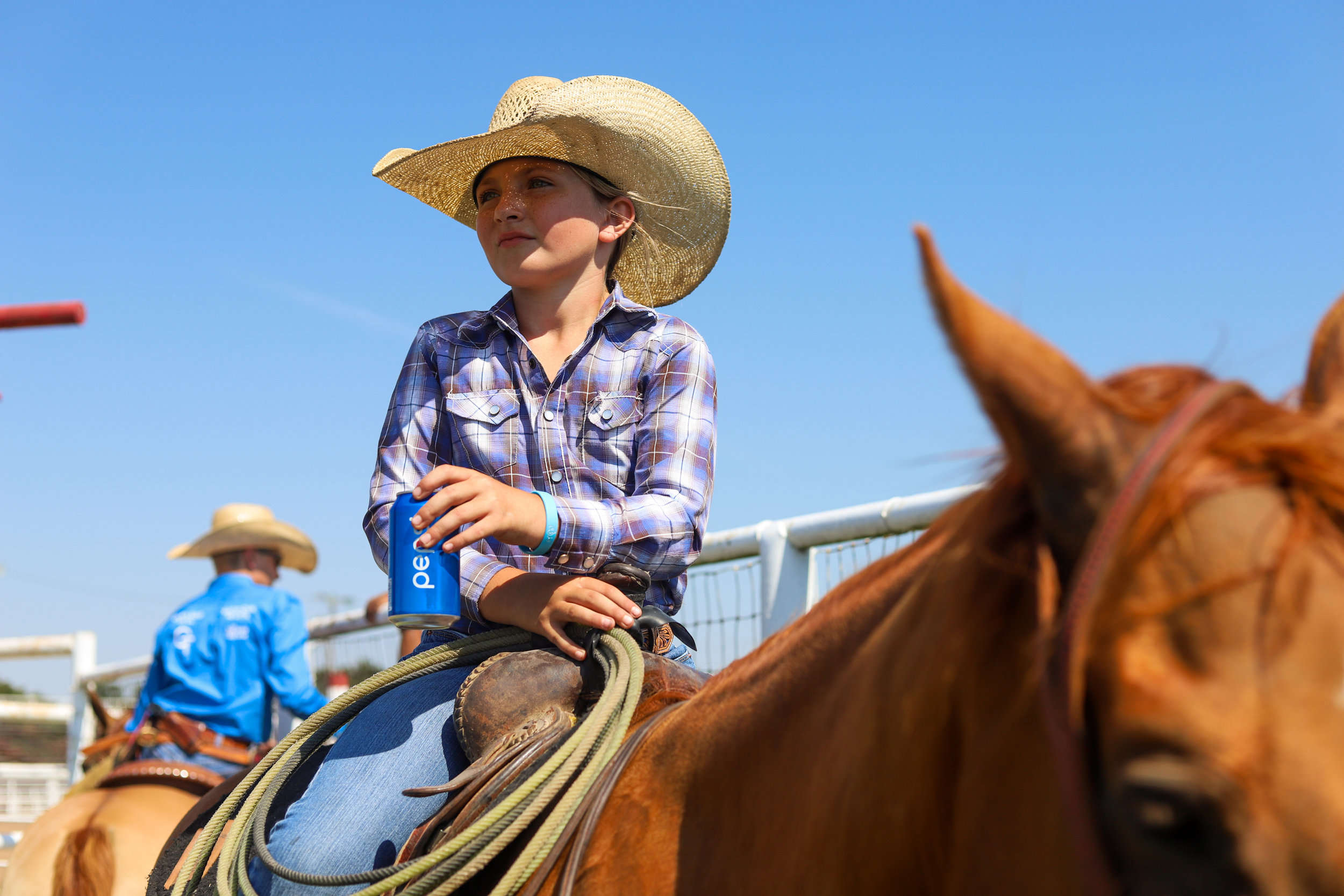 10-year-old Rowdy Stierwalt waits for her first event during the youth ranch rodeo at the 101 Arena in Ponca City, Oklahoma.