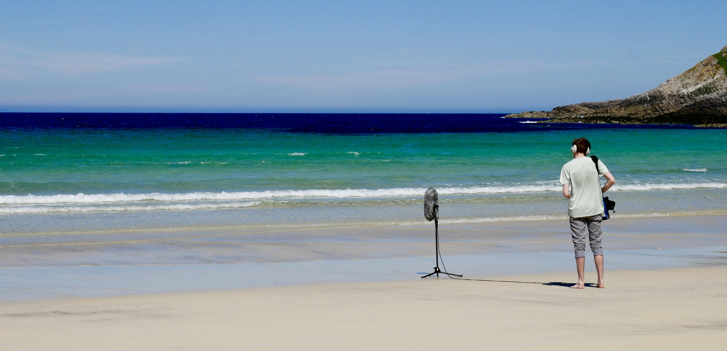 A picture of me recording the soundscape of Feall Bay, Coll.